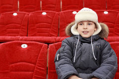 Boy sits in expectation of  hockey match Stock Photography