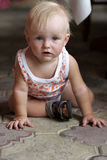 Boy sits on the floor Royalty Free Stock Images