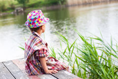 The boy next to the river Stock Photography