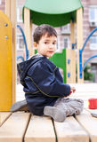 Boy sits on playground Royalty Free Stock Photography