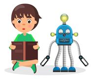 Boy Sits and Reads Book Beside Robot with Lamps Stock Photo