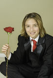 Boy Sits with Rose, Valentine's Day Stock Photo