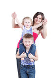 Boy sits on shoulders of older brother, mother oxters him Royalty Free Stock Image