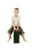 The boy sits on  suitcase Royalty Free Stock Photo