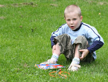 Boy Sitting. Young boy sitting on grass royalty free stock photography