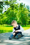 Boy sitting Stock Image