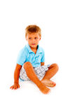 Boy sitting. In white background Royalty Free Stock Image