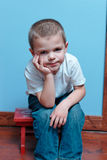 Boy sitting Stock Images
