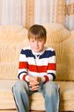 Boy sitting Stock Photo