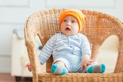 Boy is sitting on armchair. Studio shot Stock Photography