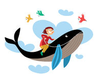 Boy sitting astride a whale Stock Photos