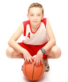 Boy sitting with the ball. On the isolated Royalty Free Stock Photos