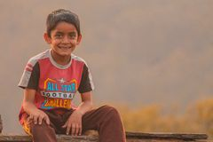 Boy Sitting On Bench royalty free stock images