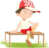 A Boy Sitting on Bench Stock Photos