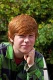 Boy sitting on a bench Stock Photo