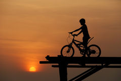 A boy sitting on bicycle  Stock Images