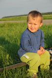Boy sitting on bicycle wheel Stock Image