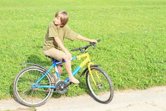 Boy sitting on a bike Royalty Free Stock Photo