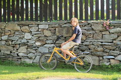 Boy sitting on a bike Stock Photo