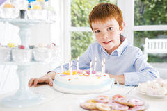boy sitting at birthday tea table Royalty Free Stock Image