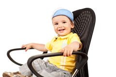 Boy sitting on a black chair Stock Image