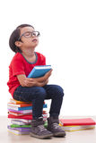 Boy sitting on books Royalty Free Stock Photography