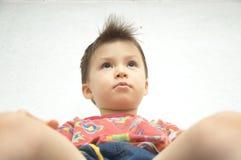 Boy sitting, bottom view Royalty Free Stock Photography