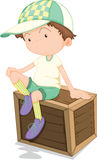 A Boy Sitting on a Box Royalty Free Stock Images