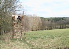 Boy sitting on bryony Stock Image