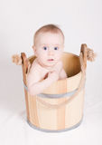 Boy sitting in a bucket Stock Images