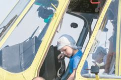 Boy sitting in cabin of the MI-8 helicopter Stock Image
