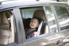 Boy sitting in car with safety belt Royalty Free Stock Photography