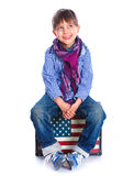 Boy sitting on a case Royalty Free Stock Image