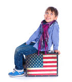 Boy sitting on a case Royalty Free Stock Photography