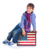 Boy sitting on a case Royalty Free Stock Photos
