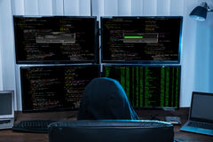 Boy Sitting On Chair Hacking Multiple Computers Stock Photo