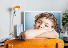 Boy sitting on chair Royalty Free Stock Photography