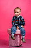 Boy sitting on the ottoman Royalty Free Stock Photography
