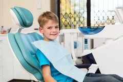 Boy sitting dentist office Stock Photography
