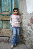A boy sitting at the doorstep stock photography