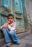 A boy sitting at the doorstep and thinking. (an expression of equal opportunity Royalty Free Stock Photos