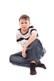 Boy sitting on the floor Royalty Free Stock Photography
