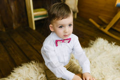 Boy sitting on fur Stock Photo