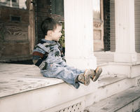 Boy sitting on gallery Royalty Free Stock Image