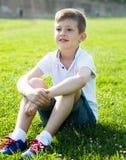 Boy sitting grass Royalty Free Stock Photography