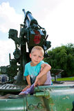 Boy sitting on the gun Royalty Free Stock Photos