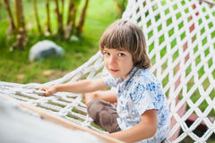 Boy sitting on a hammock. Stock Images