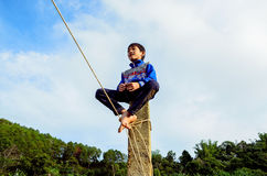Boy sitting on a high. In Sea Lake, Gia Lai, ViET nAM Royalty Free Stock Images