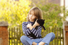 Boy Sitting Holding a Kitten Royalty Free Stock Photography