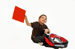 Boy sitting and holding red folder Stock Images